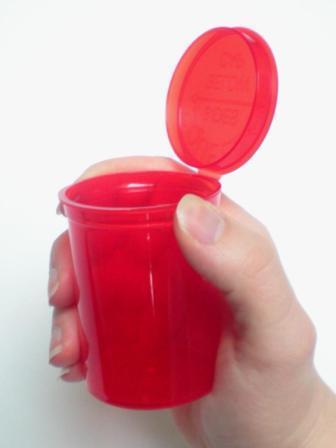 aev335-red-vial-hand-w